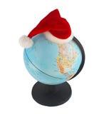 Globe dans le chapeau de Santa Photo stock