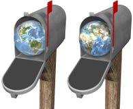 Globe de la terre dans la boîte aux lettres Images libres de droits