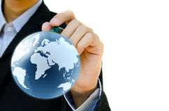Globe de la terre de retrait de main. Images libres de droits