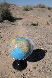 Globe in the desert Royalty Free Stock Image
