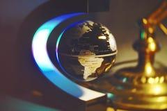 Globe on desk Royalty Free Stock Images
