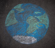 Globe dessiné sur l'asphalte illustration stock