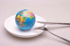 A globe in dish. A globe in a white dish,look like will be eaten Royalty Free Stock Photos