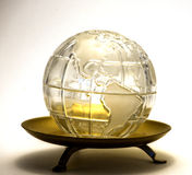 Globe in a Dish. Image of a glass globe in a golden colored dish Stock Photography