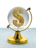 Globe and dollar. The globe and dollar. The glass globe on a yellow support, with a sign on dollar inside Stock Photo