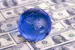 Globe on dollar bills Stock Photo