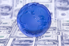 Globe on dollar bills Royalty Free Stock Photo