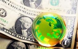Globe dollar. Glass globe and reflection of dollar bill Stock Photo