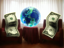 Globe and dollar in living room Stock Photos