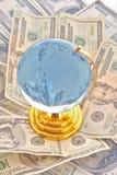 globe and dollars stock photos