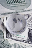 Globe on dollars. Currency concept Stock Images