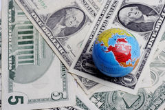 Globe on dollars. Currency concept Royalty Free Stock Image