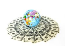 Globe and dollars Royalty Free Stock Image