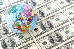 Globe and dollars Stock Photo