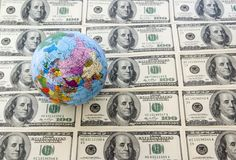 Globe and dollars Stock Photo