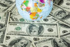 Globe and dollars Stock Images