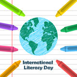 Globe drawing and crayons. International Literacy day design Stock Photos