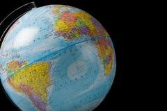 Globe du monde sur le noir Image libre de droits