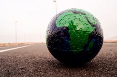 Globe Earth on an Asphalt Street. Conceptual Image Globe Earth on an Asphalt Street stock photo