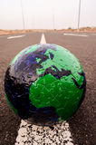 Globe Earth on an Asphalt Street Royalty Free Stock Photo