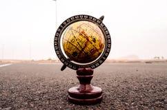 Globe Earth on an Asphalt Street Stock Photo