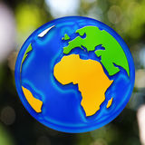 A globe. Earth on a green background Stock Photos