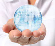 Globe earth in hand Stock Photos