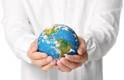 Globe, earth in  hand Royalty Free Stock Photo