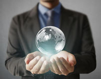 Globe ,earth in human  hand holding our planet earth glowing. Ea Stock Photography