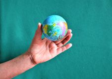 Hands of woman holding globe stock photo