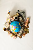 Globe Earth and Money Royalty Free Stock Images