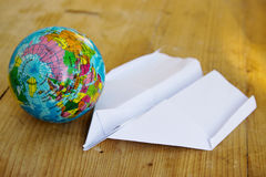 Globe Earth and Paper Plane Royalty Free Stock Photography