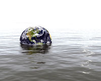 Earth threatened by floods. Globe of Earth and rising waters Stock Photography