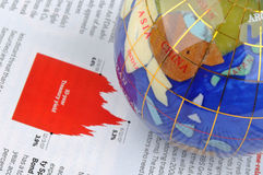 Globe and economy information. A colorful globe putting on information of economy, means world wide economy, development and business concept Stock Photos