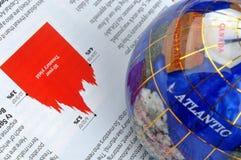 Globe et graphique d'économie Photographie stock