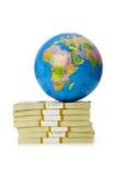 Globe et pile de dollars Images stock