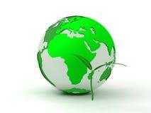 Globe et une pousse Photos libres de droits