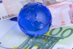Globe on Euro banknotes Stock Images