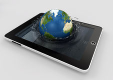 Globe falling into the device's screen Royalty Free Stock Images