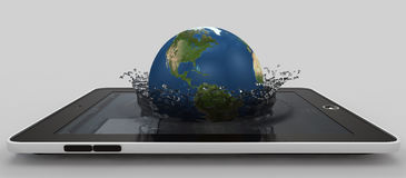 Globe falling into the device's screen Stock Photos
