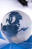 Globe with financial papers. Business and financial concept royalty free stock photos