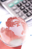 Globe with financial papers. Business and financial concept stock photo