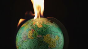 Globe on fire stock footage