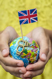 Globe with the flag of Great Britain and metal handcuffs with the words Freedom. Globe with the flag of Great Britain and metal handcuffs with the words Freedom Royalty Free Stock Photography