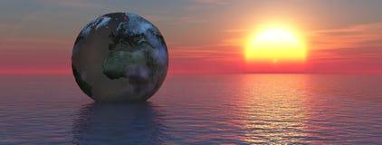 Globe floating on the sea Stock Image