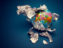 Globe in foil of aluminum. This is  globe in foil of aluminum. It is theme of geography Royalty Free Stock Photo
