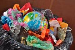 Globe in the garbage bin Royalty Free Stock Photo