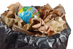 Globe in the garbage bin Royalty Free Stock Images