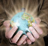 Globe in a girl's hands Royalty Free Stock Photos
