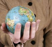 Globe in a girl's hands Royalty Free Stock Photography